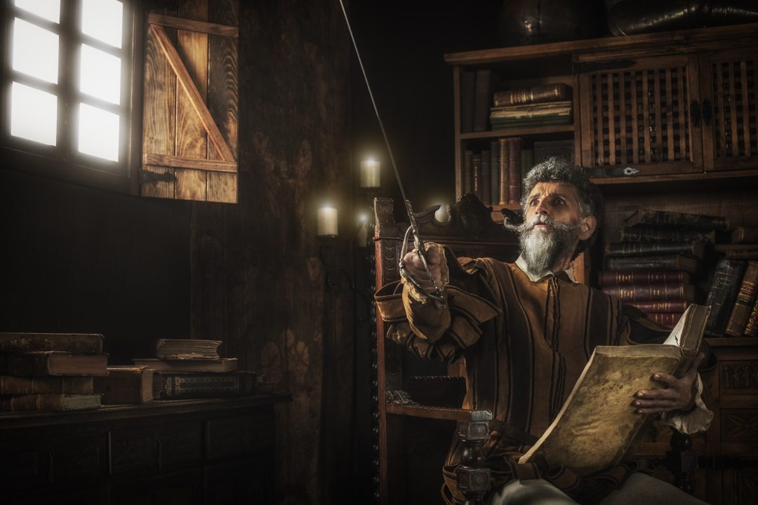 Don Quixote loosing his mind while reading chivalry books